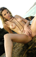 Gisele posing nude on the beach from Lil Latinas