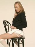 Jeannie Marie poseing in her school uniform from New Sensations