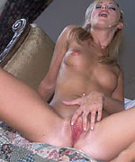 Perfect blonde totally nude inserting a big dildo into her cunt from Screaming O