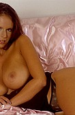 Raylene Richards bares boobs as a brunette from Raylene Richards