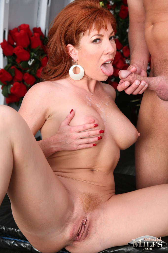 A thick redheaded slut gets nice her tits squeezed then fucked hard 4